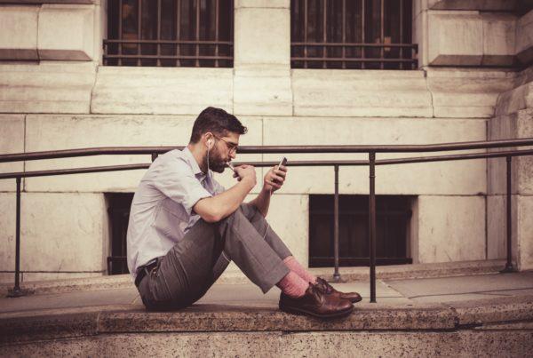 phone guy sitting